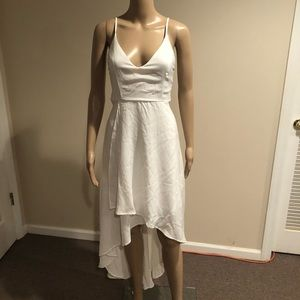 Beautiful white Plunging dress with tie back
